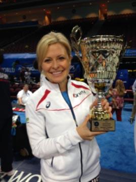 Dr. Kells holding world wrestling championship trophy